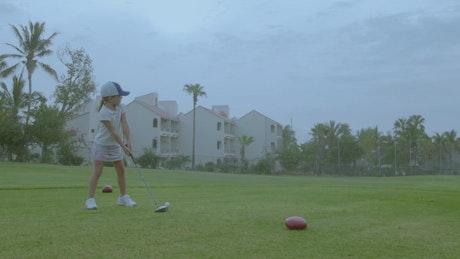 Girl practising golf