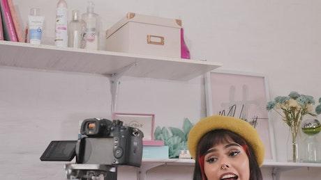 Girl recording a makeup tutorial in a set