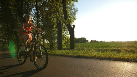 Girl riding a bike on a warm evening