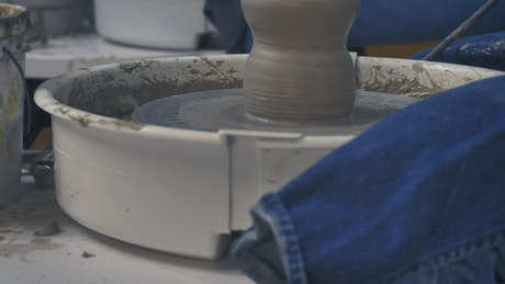 Girl shaping clay during a pottery class