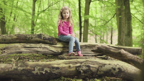 Girl sitting in the forest