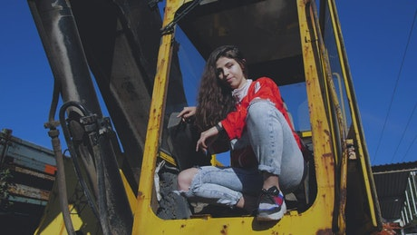 Girl sitting on a tractor