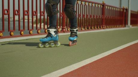 Girl sliding with roller skates