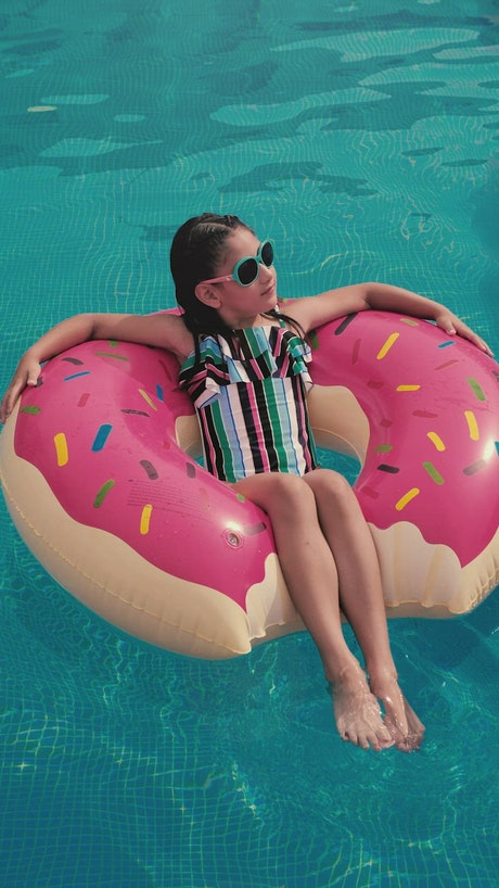 Girl taking the sun in a pool