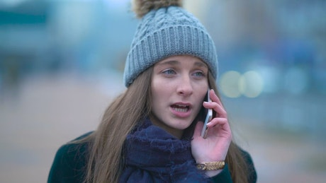Girl talking on the phone while walking