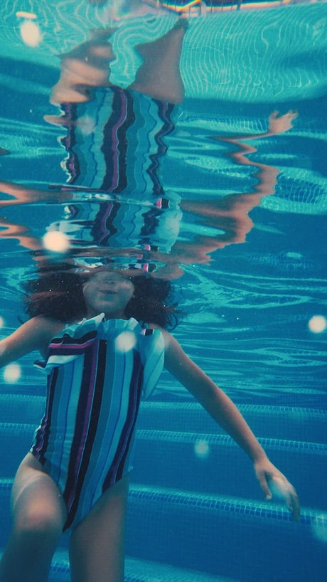 Girl underwater in a pool
