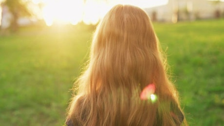 Girl walking outside looking backwards