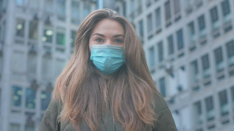 Girl with a mask in the city, portrait
