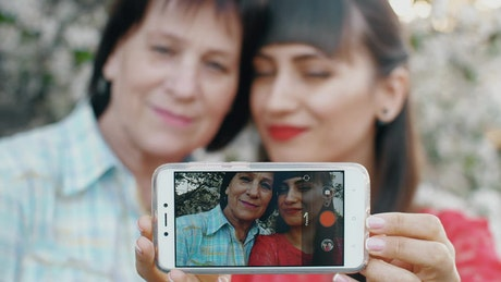 Girl with her mother taking a selfie together