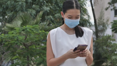 Girl with masks chatting on her cell phone