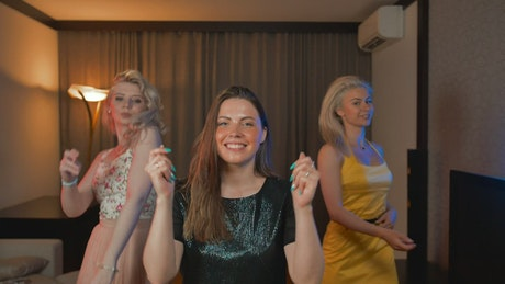 Girls dancing happily in a room