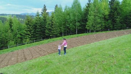 Girls playing beside a farm field