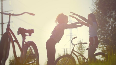 Girls stretching after a bike ride outdoors