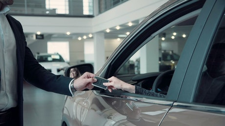 Giving a car key to client