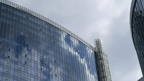 Glass buildings and cloudy sky
