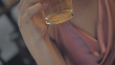 Glass of beer being drunk by a woman