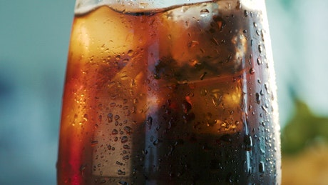 Glass with cold coke and ice
