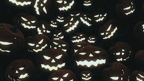 Glowing halloween pumpkins in the dark