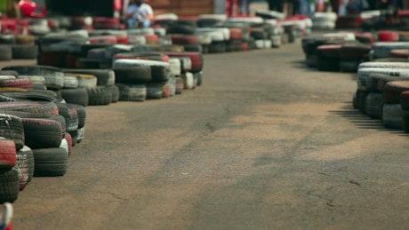Go-kart racing between tires