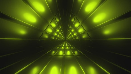 Going through a triangular tunnel lit up in green