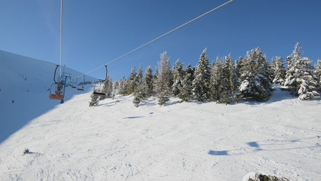 Going up the snowy mountain in a ski resort