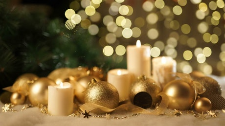 Gold Christmas ornaments and candles