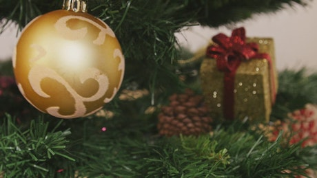 Golden ball on a Christmas tree