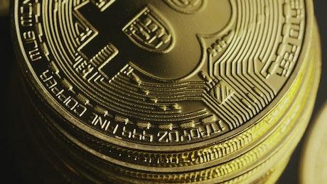 Golden bitcoin coin tower