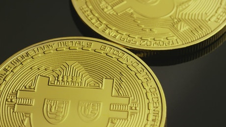 Golden bitcoin coins in a close-up shot