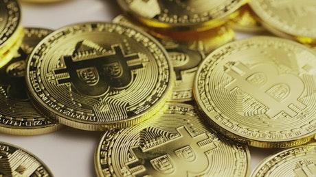 Golden bitcoin coins slowly spinning