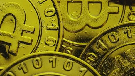 Golden bitcoin coins while rotating