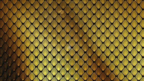 Golden decorations of plants on a wall