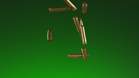 Golden falling bullets with green background