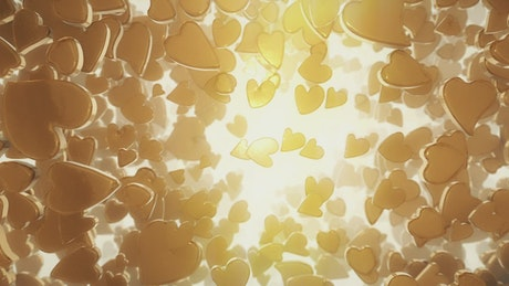 Golden heart shaped candies floating