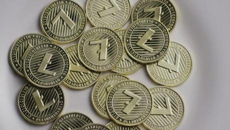 Golden Litecoin coins slowly spinning