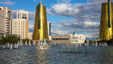 Golden towers, buildings, and a fountain