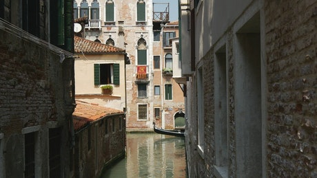Gondola moving in a canal in Venice