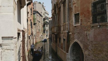 Gondola sailing in a Venice canal