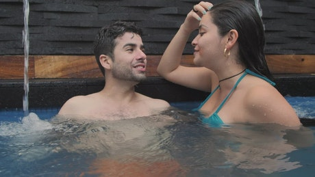 Good friends talking in a swimming pool