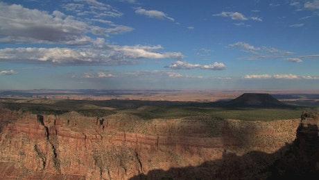 Grand Canyon and plain landscape