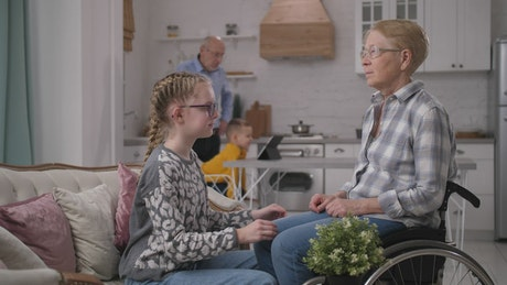 Granddaughter assisting her relative