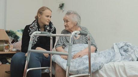 Granddaughter visiting an elderly relative