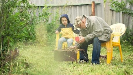 Grandfather preparing a campfire