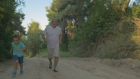 Grandfather running through the woods