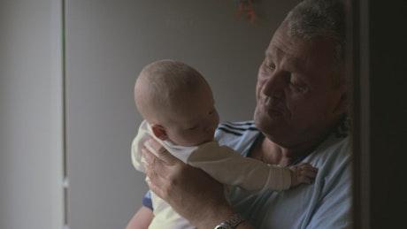 Grandfather with a newborn
