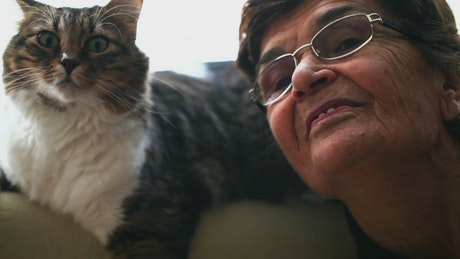 Grandmother chatting with her cat