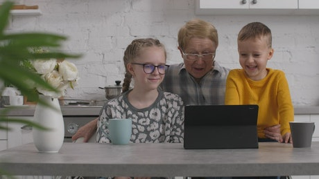 Grandmother enjoying a video with her family