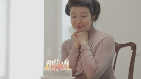 Grandmother on her birthday with a cake with candles