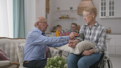 Grandparents checking their blood pressure