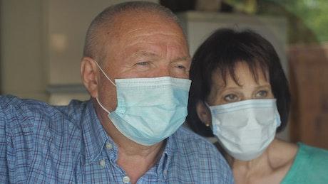 Grandparents wearing masks